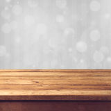Winter bokeh background. With wooden table stock images