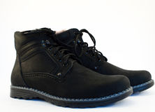 Winter boots. Pair of winter black leather boots isolated on white Stock Photo