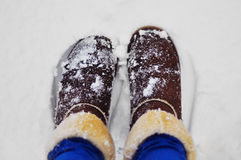 Winter boots. Brown winter boots in the snow Royalty Free Stock Photo