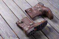 Winter boots of cowboy. Winter boots of cowboy on a wooden surface stock photography