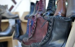 Winter boots display for sale in clothing store. Image of a Royalty Free Stock Photo
