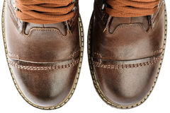 Winter boots, men's, brown, with laces and thick soles. Winter Men's lace boots with fur, isolated on white background Stock Images