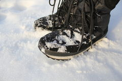 Winter Boots On Snow Stock Photos