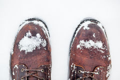 Winter boots in snow stock photos