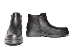Winter boots on a white background Stock Photos