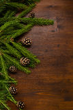 Winter border: larch and fir branches and pine cones on the wood. Flat lay chrismas rpattern, larch and fir branches and pine cones on the wood desk. emty space Stock Photo