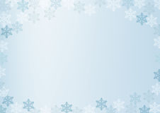 Winter border with white and blue snowflakes on blue blurred soft background. Christmas and New Year holiday wallpaper Stock Photo