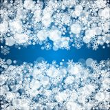 Winter border with white snowflakes. For Christmas and New Year celebration. Holiday winter border on blue background for banners, gift coupons, vouchers, ads Stock Photography