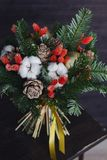 The winter bouquet made of fir branches, Christmas balls and dri Royalty Free Stock Photo