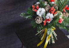 The winter bouquet made of fir branches, Christmas balls and dri Royalty Free Stock Photography