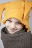 Winter boy. Smiling boy in warm yellow hat and scarf stock photo