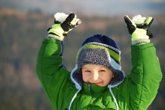 Winter Boy. A portrait of a happy young boy dressed in warm winter clothes Stock Photo
