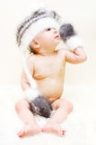 Winter boy. Baby poy in a winter hat and mittens Royalty Free Stock Photography