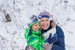 Winter boy with mother Royalty Free Stock Photo