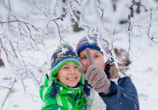 Winter boy with mother Royalty Free Stock Image