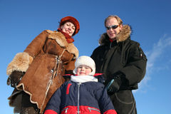 Winter boy with parents Stock Image