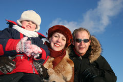 Winter boy with parents2 royalty free stock image
