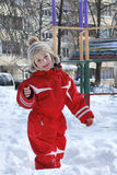 Winter boy playing in the snow near the playground. Stock Photo