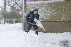 Winter boy with a shovel. Winter blizzard with a shovel is a boyfriend, boy with a shovel stock photography