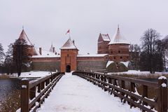 Winter break castle on the river bank stock image