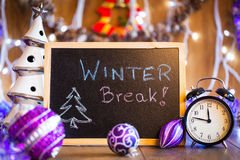 Winter Break written on the black chalkboard. With Christmas decorations and lights Stock Photo
