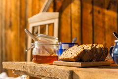 Winter breakfast outside wooden cottage Royalty Free Stock Photo