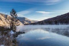 Winter breath of the Yenisei River. Morning. A light mist on the Yenisei. Sayan. Khakassia. Siberia Stock Image