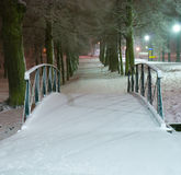 Winter bridge. A small footbridge in a winter evening. Nearby Roserseberg palace north of Stockholm Royalty Free Stock Photography