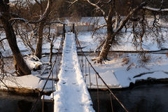 Winter Bridge. The old winter bridge in a sunny day Royalty Free Stock Photography