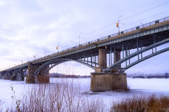 Winter bridge. Bridge over the river covered with ice Royalty Free Stock Images