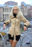 Blonde woman stands at the bridge in Kyiv. Ukraine, Kiev. Blonde girl on the winter bridge at Maidan royalty free stock photography