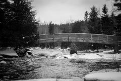 Winter Bridge. A walk bridge leading over a river in Northern Wisconsin Stock Photo