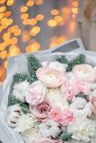 Winter bright bouquet of mixed flowers with cotton, pine branches Nobilis and Ranunculus. Floral Bunch with Persian royalty free stock photos