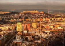 Winter in Brno. Castle Spilberk and the old Brno in the winter with snow dusting, view from the district Kamenka in the late afternoon sun stock photography