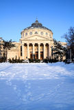 Winter in Bucharest - the Athenaeum. The Romanian Athenaeum is a concert hall in the center of Bucharest, and a landmark of the Romanian capital city. Opened in Royalty Free Stock Photos