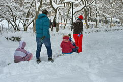 Winter landscape. Winter with snow in Bucharest, Romania. Family in the park Stock Image