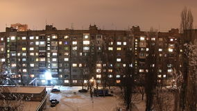 Winter. Buildings with flats at night, timelapse. Royalty Free Stock Photos