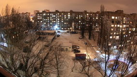 Winter. Buildings with flats at night, timelapse Stock Photo