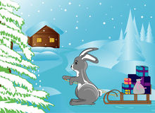 Winter bunny brings Christmas presents to the house Royalty Free Stock Photo