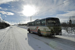 Winter bus. Bus on a ice road in tundra Stock Photo