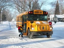 School Bus. Student entering bus on a cold winter day Royalty Free Stock Image