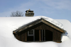 Winter Cabin. Wooden cabin, covered in a LOT of snow, Norway Royalty Free Stock Images