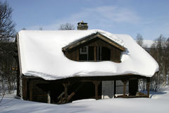 Winter Cabin. Wooden cabin, covered in a LOT of snow, Norway Stock Photo