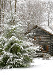 Winter cabin. A log cabin in a snow covered wooded area Royalty Free Stock Photos