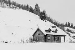 Winter cabin at the base of a hill Stock Photo