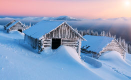 Winter, cabins, mountains Stock Photo