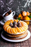 Winter cake with Mandarin. Homemade cake with fruits and candy royalty free stock image