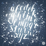 Winter calligraphy english alphabet with snow Royalty Free Stock Images