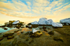 Winter calm sea. At sunset in winter Royalty Free Stock Photos