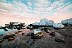 Winter calm sea. At sunset in winter. Delicate pink clouds Royalty Free Stock Photos